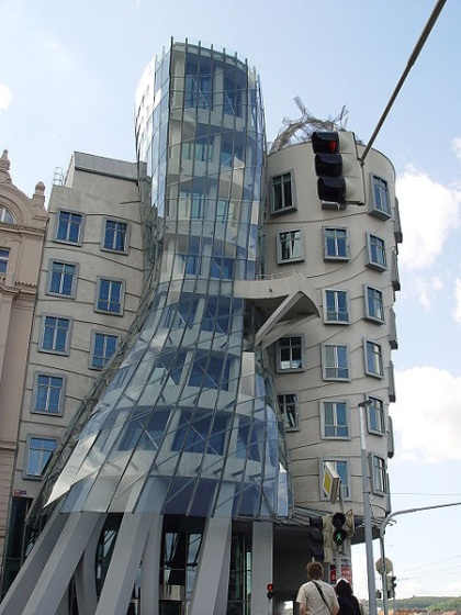 Designed by Czech architect Vlado Milunić in co-operation with Canadian architect Frank Gehry, the house vaguely resembles a pair of dancers. The building is located in downtown Prague, Czech Republic